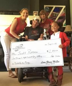 ALS In Wonderland in Cabot, Arkansas dropping off a crowd funding check to the Pattersons. Director of Crowd Funding for this check, Allison West Davis.